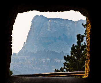 The last tunnel on Iron Mountain Road beautifully frames Mount Rushmore.