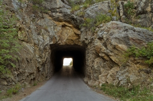 The other end of this final tunnel on Iron Mountain Road frames Mount Rushmore.