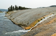 Boiling water from Excelsior Geyser running down into Firehole River.