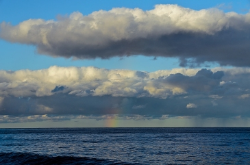 Rainbow in the clouds viewed from the beach in front of our cabin.