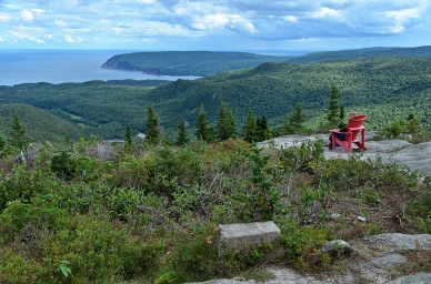 Jen sitting at the top. Franey Mountain in the Cape Breton Highl